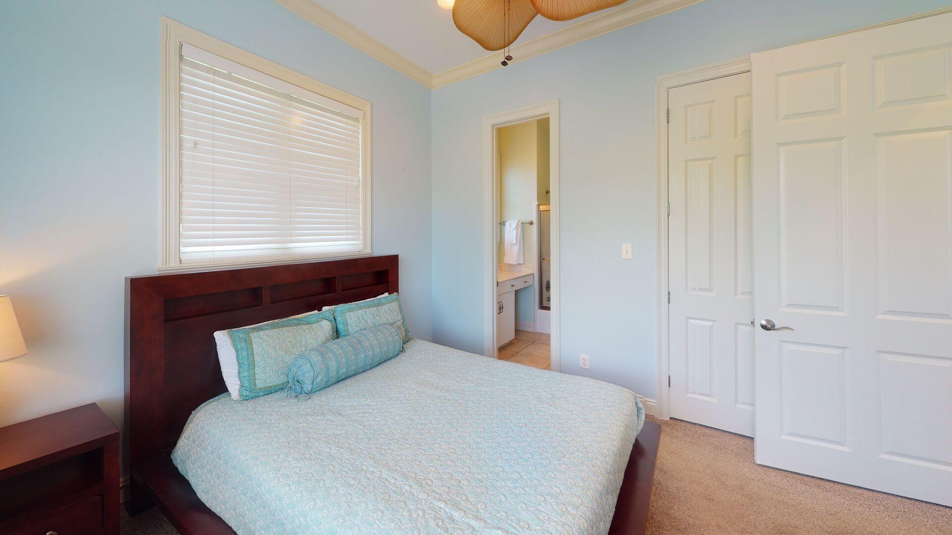 2nd floor bedroom 2 has a queen bed and TV