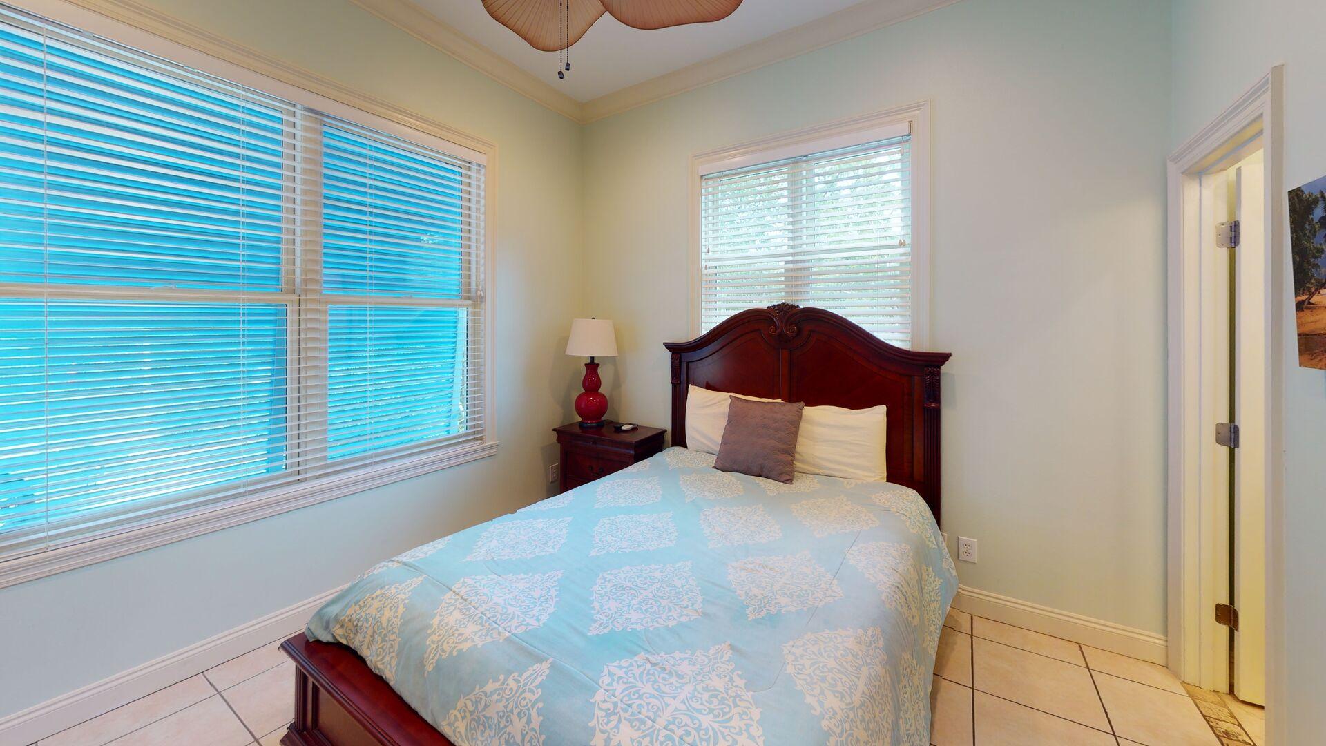 Ground floor bedroom 3 has a queen bed
