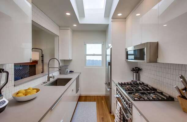 State-of-the-Art Kitchen with oven, sink and fridge