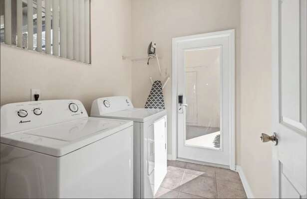 The laundry room has a washer, dryer, and ironing board for your convenience