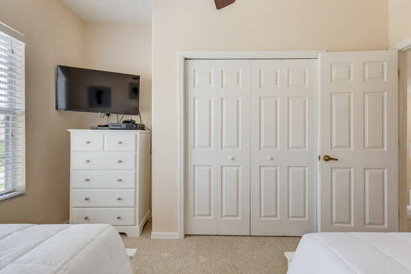 Large closet for storage and a TV