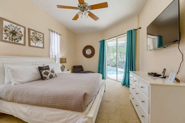 The master suite is located on the ground floor and has access to the outdoor patio