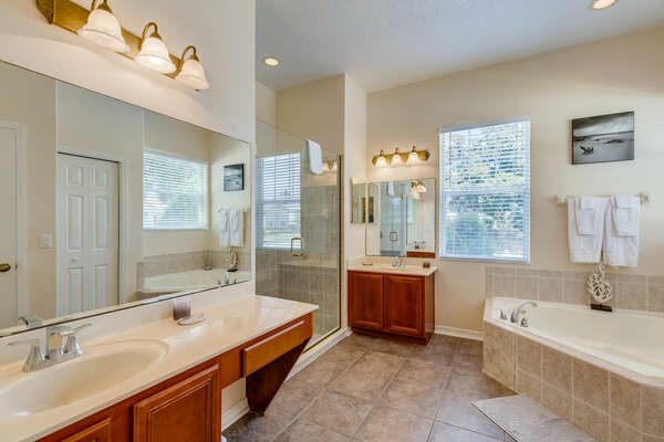 The large ensuite bathroom has a garden tub and walk-in shower