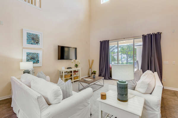 The living area leads right to the patio and has plenty of space for the whole family to gather together