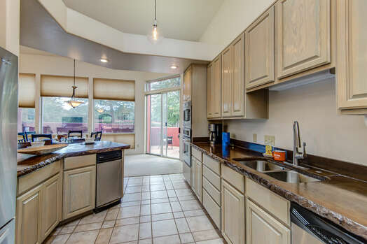 Fully Equipped Kitchen and Plenty of Granite Counter Space