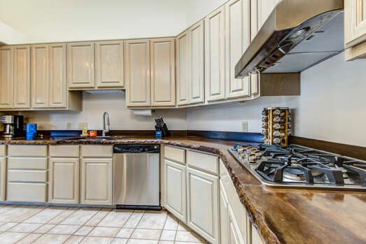 Stainless Steel Appliances Including a Gas Stovetop and a Convection Oven