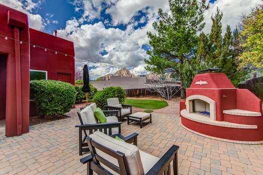 New Outdoor Gas Fireplace and Seating Area with Red Rock Views