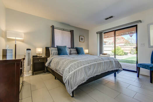 Master Bedroom with a King Bed and Backyard Access