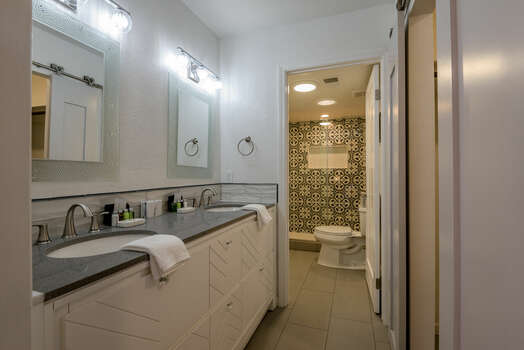 Master Bath with Dual Stone Counter Sinks and Separate Shower