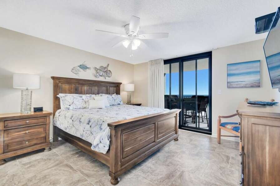 Master Bedroom has a King Size Bed with a Private Master Bath and Balcony Access