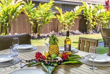 Fresh fruit and wine on a table in the front lanai.