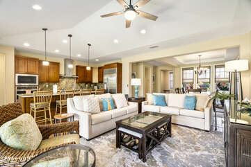 The living area of this Holua Kai at Keauhou rental, with two couches and a glass-topped coffee table.