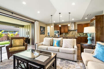 White couches highlight the living area.