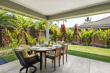 Views form the front porch of the tropical landscaping surrounding this Holua Kai at Keauhou rental.