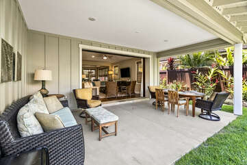 A wicker couch and chairs on the front lanai of this Holua Kai at Keauhou rental.