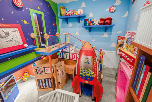 Slide into non-stop fun in the two-story Toy-Land themed playroom