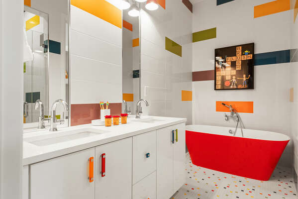 Bathroom with standalone tub connected to kids room
