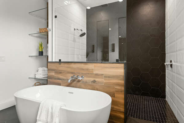 Ensuite bathroom with standalone tub and walk-in shower