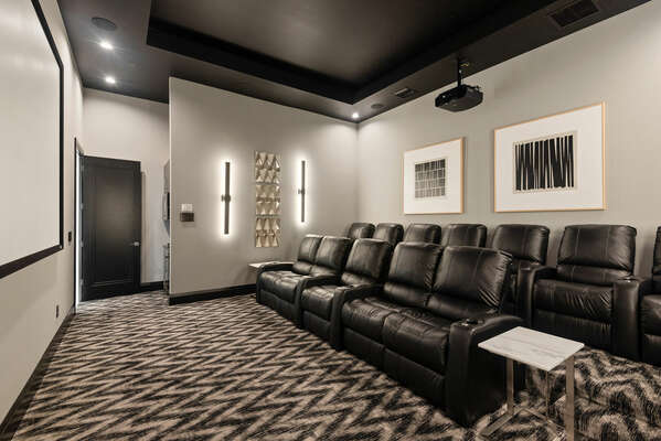The theater room comes with 12 recliner seats to sit back, relax, and watch a movie
