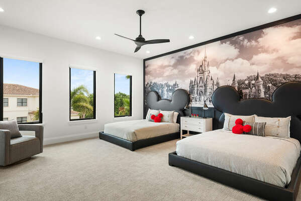 Two queen-size beds in an upstairs bedroom