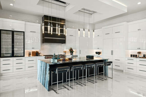 The kitchen features a 60-inch range(stovetop), microwave drawer, and a state-of-the-art refrigerators