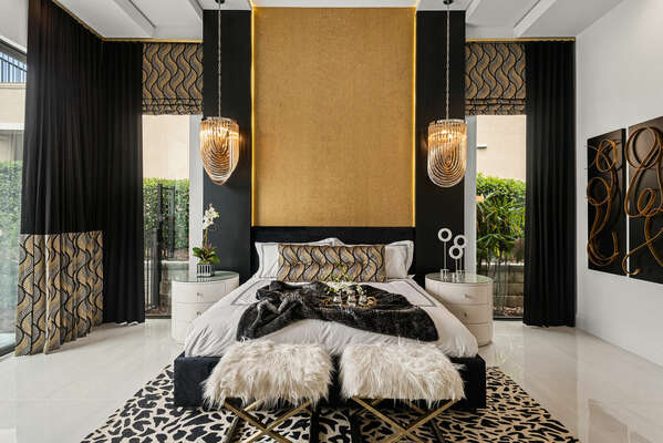 The ground floor Grand Master Suite is furnished with a king-size bed