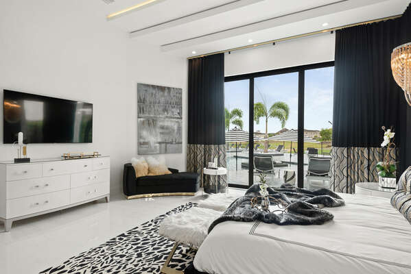 Enjoy a view of the pool from the ground floor Grand Master Suite