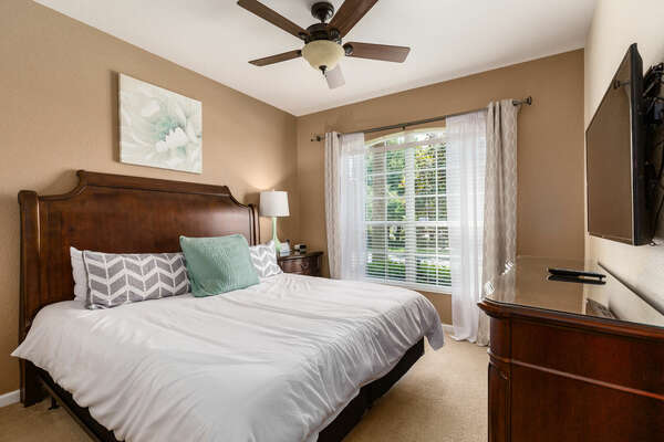 The master bedroom has a king bed