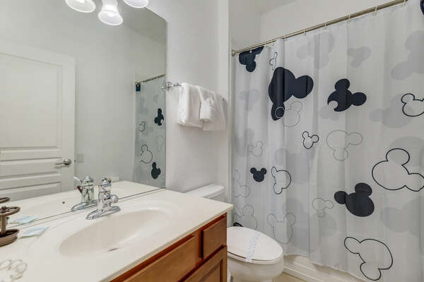 Family style bathroom near the theater and game room