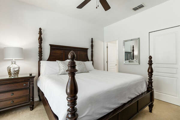 The second master bedroom has a king bed with view to the pool area