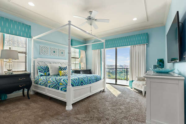 This bright second floor bedroom has access to the balcony and will help you truly vacation