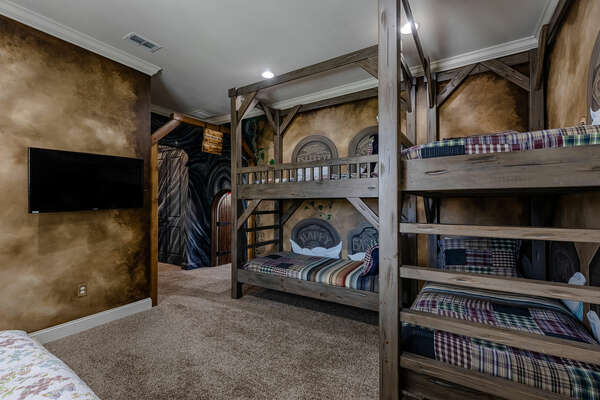 Featuring 2 twin over twin bunk beds, a daybed, and an ensuite bathroom