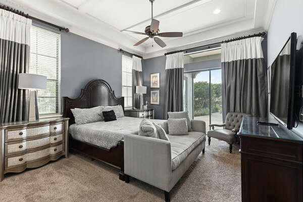 Ground floor master suite with sliding glass doors out to the patio