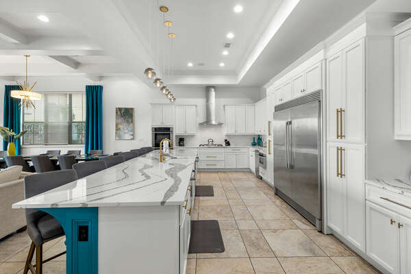 The kitchen features stainless steel appliances, custom cabinetry, breakfast bar seating for 5 and granite counters