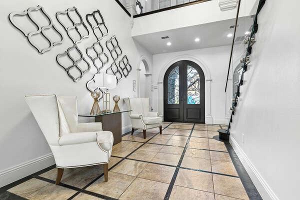 Walk through the elegant foyer to the living area