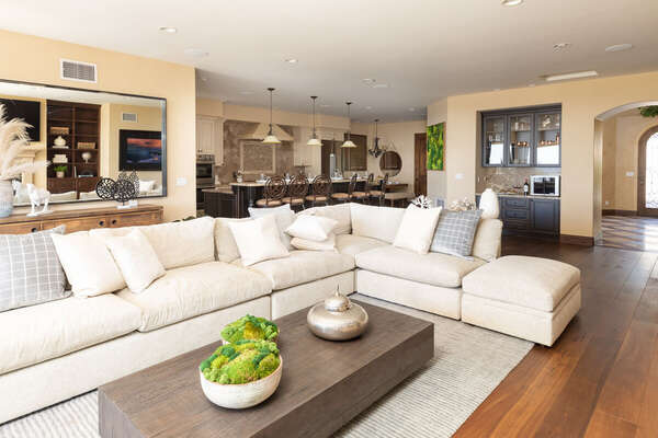 Luxurious Living Area Features White Sectional.