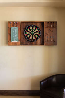 Billiards Room Features a Dart Board.