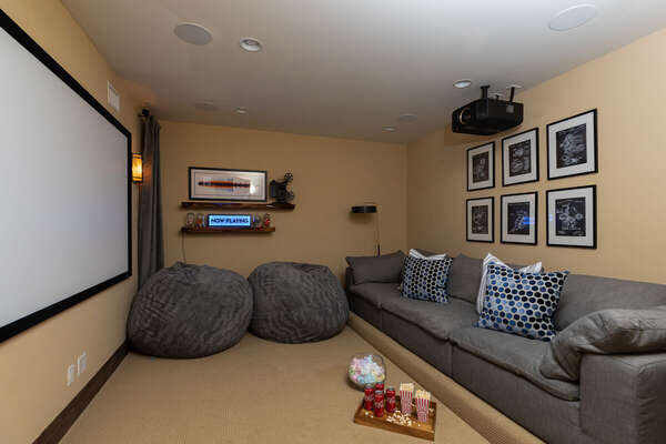 Theater Room Includes Large Grey Couch.