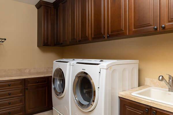 Laundry Room Includes a Washer and Dryer.