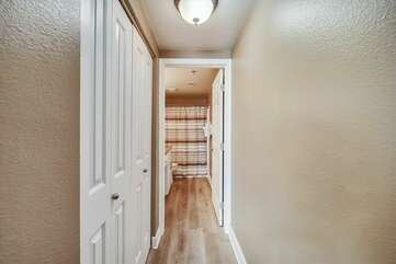 Hallway to the Master bathroom with double closet on your left