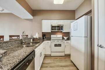 Beautiful kitchen that is furnished with all cooking essentials