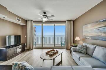 Gorgeous view of the Gulf from the living room. Mounted TV and sleeper sectional for additional guests