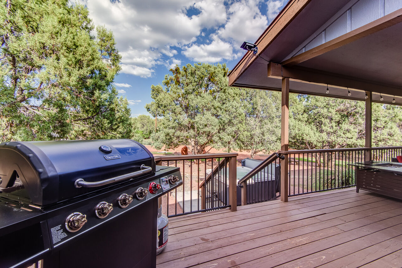 Large Deck Across the Back of the House with Charcoal Grill