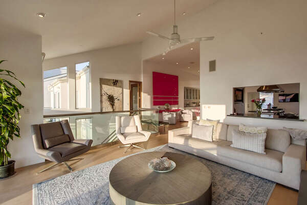 Upper Level Living Room with Leather Couch and Chairs