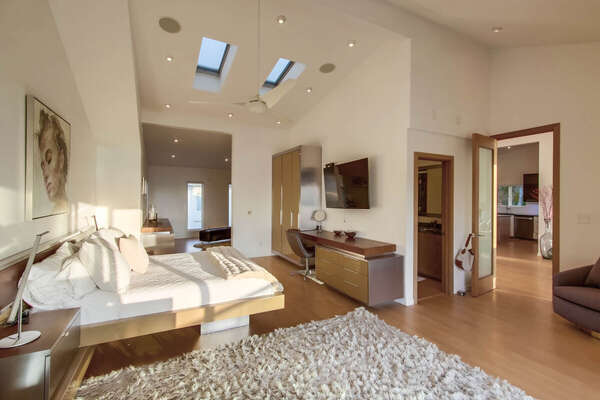 Master Bedroom Suite with King Bed, Desk, and TV