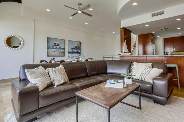 Large Brown Sectional in Living Space.