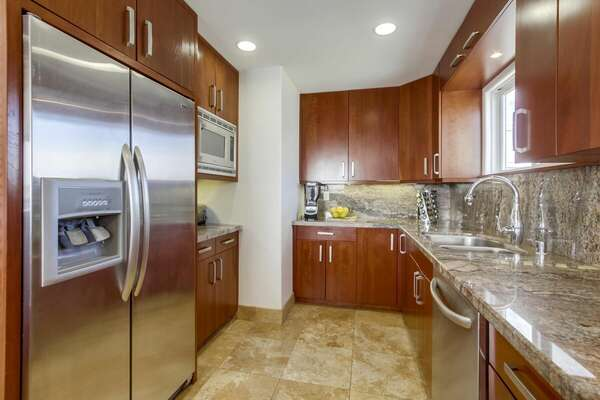 Spacious Kitchen Features Wooden Cabinets.