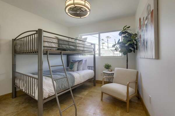Bedroom Features Bunk Bed and Accent Chair.