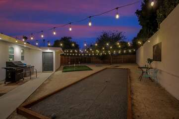 Make sure you challenge your friends to a game on the professional bocce ball court. This area lights up so nice!