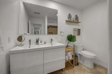 The hallway bathroom is located at the end of the hallway and features dual sinks and a combo shower/tub.